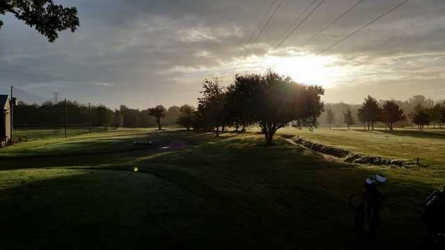 Sun shining over the fairway at Widney Manor Golf Club