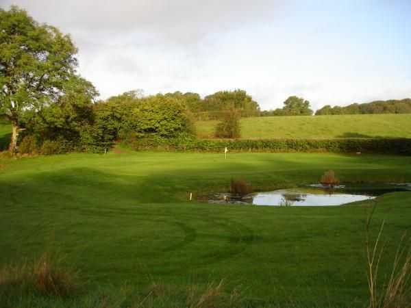 View of the well protected 4th green at Coed-y-Mwstwr Golf Club