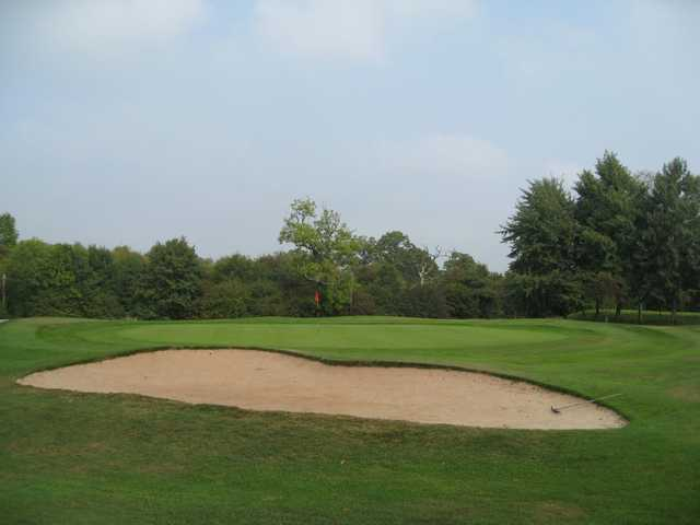 The 16th green and greenside bunker at Oakridge Golf Club