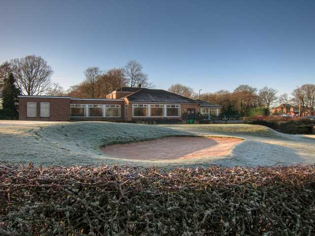 10th hole in the frost and clubhouse at Heaton Moor Golf Club