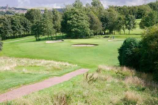 Bunkers surround the 6th green at Crompton & Royton Golf Club