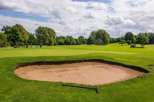 A view of a hole protected by a bunker at Colin Park Leisure Golf Course