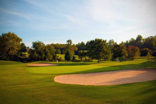 View of a bunkered green at Mountain Harbour Golf Club
