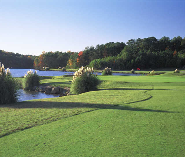 View of a green and lake at Stone Mountain Golf Course