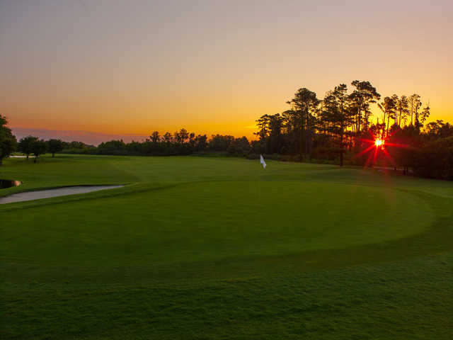 Sunrise view of the 6th green at The Pointe Golf Club