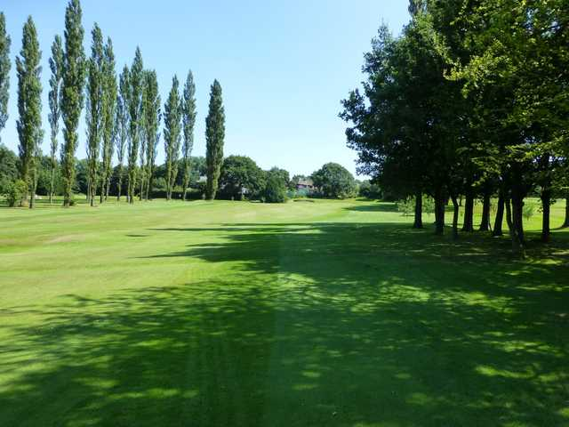 The stunning tree lined 7th fairway at Marple Golf Club