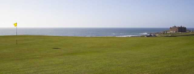 Superb green with the coast in the background at Newquay GC