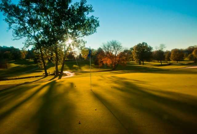 A sunny view of hole #12 at Tanglewood Manor Golf Club.
