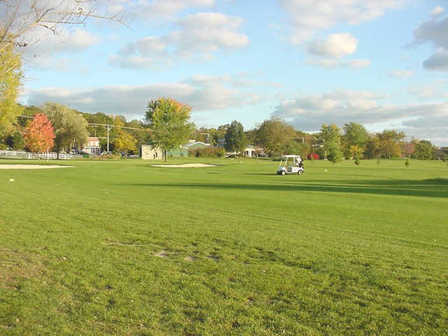 A view from Chapel Hill Golf Course with a golf cart in background
