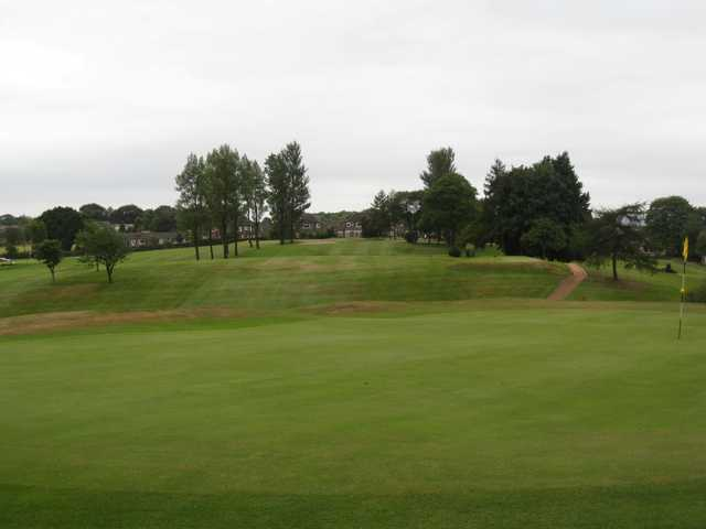 Beautiful view of the 3rd green and second hole at Harwood Golf Club