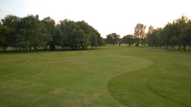 View of the tree lined 1st fairway at Shrewsbury Golf Club