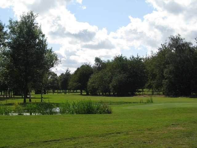 Scenic view of the 6th hole and pond at Shrewsbury Golf Club