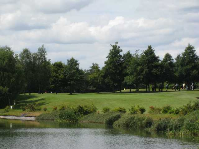 A view of the challenging 16th green and accompanying water hazard at Bromsgrove GC