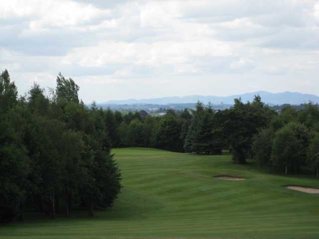 The 2nd fairway and green with surrounding trees at Bromsgrove Golf Course