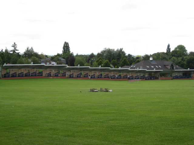 A view of the large driving range and back of the clubhouse at Bromsgrove Golf Centre