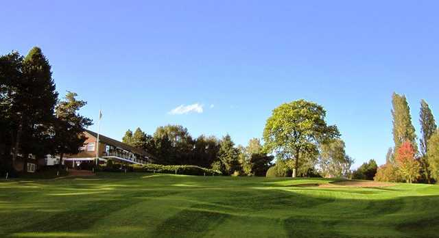 Uphill 18th fairway with clubhouse in background at Walmley Golf Club