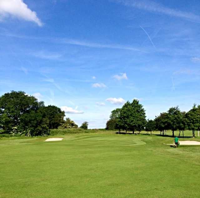 A view of the 14th green and greenside bunkers at Malkins Bank Golf Club