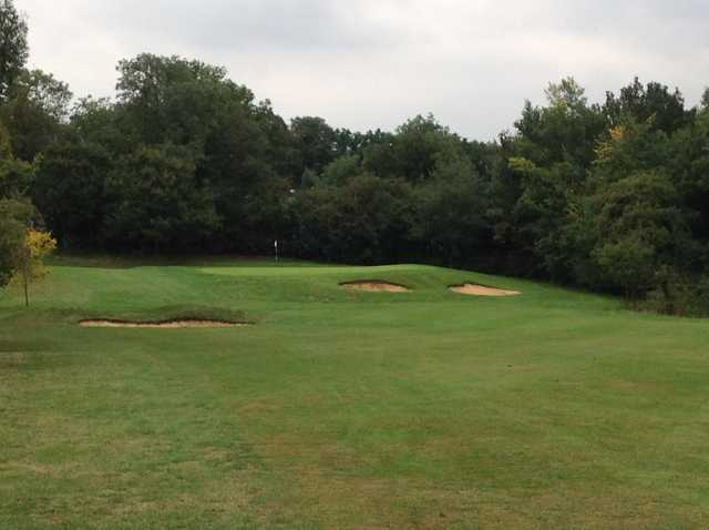The 17th green and greenside bunkers at Grims Dyke Golf Club