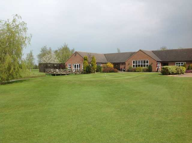 The Six Hills clubhouse overlooking the course and putting green