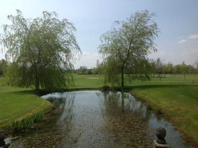View of the course and water hazards at Six Hills Golf Club