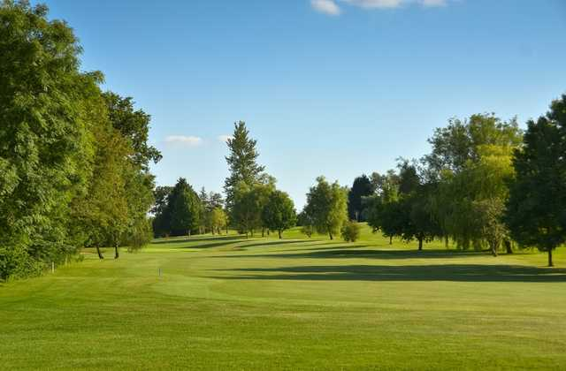 The tree  lined 3rd fairway at Chippenham Golf Club