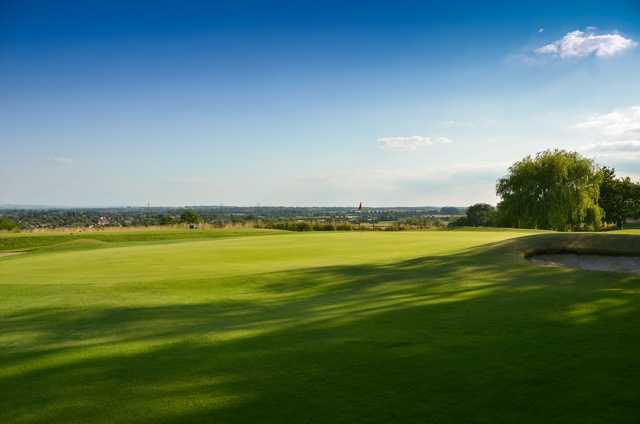 The 5th green with countryside views at Chippenham Golf Club