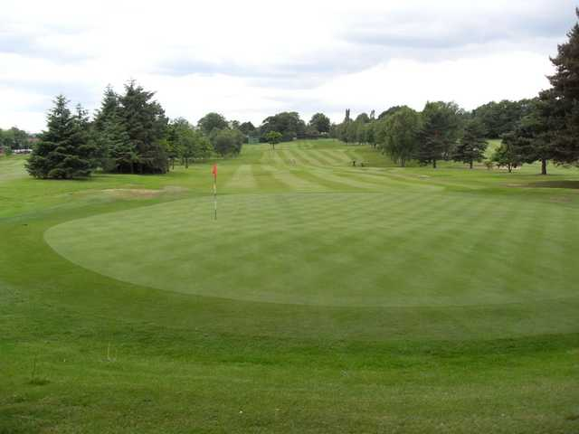 The well-manicured but sloping 17th green at Romiley
