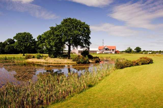 A view of the clubhouse over one of the many water hazards around the course
