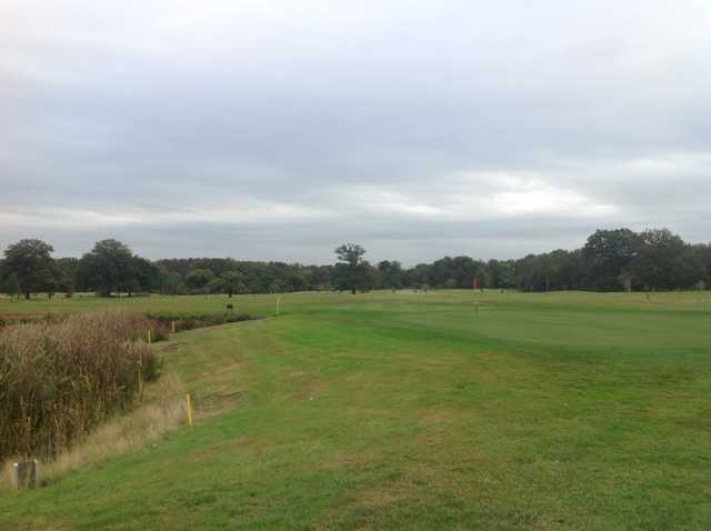 View of the 18th green and surrounding trees at Royal Ascot Golf Club