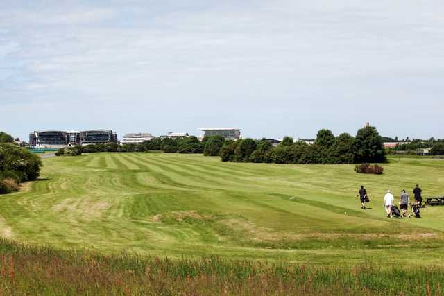 The stunning 9th hole with grandstand in the background at Aintree Golf Centre