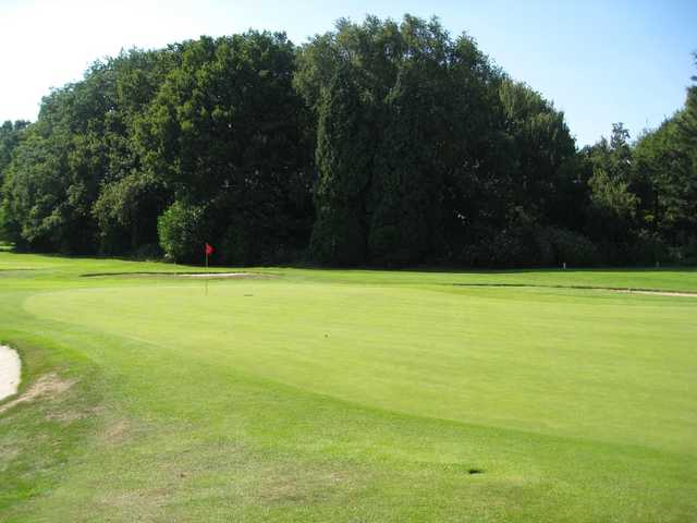 View of the 18th green in the sunshine at Northenden Golf Club