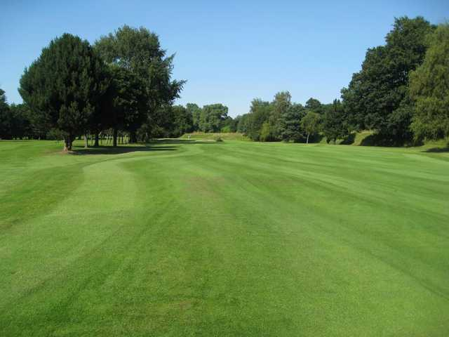 The tree lined 1st fairway at Northenden Golf Club