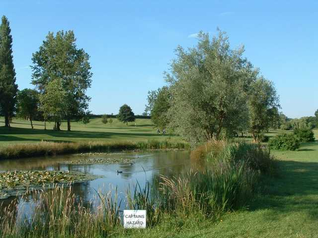 The 7th hole at Kettering as seen from the edge of the water hazard