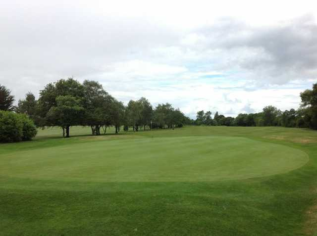 A view of the 9th green and surrounding trees at Filton Golf Club