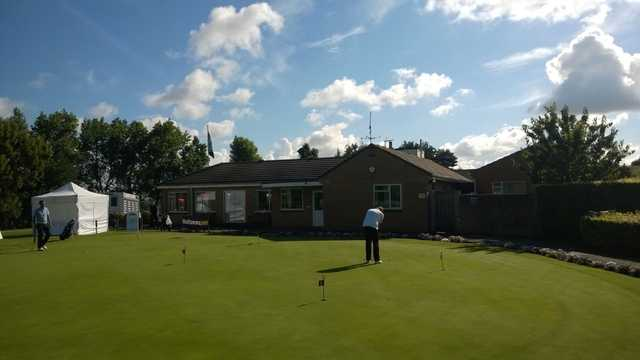 The clubhouse and putting green at Filton Golf Club