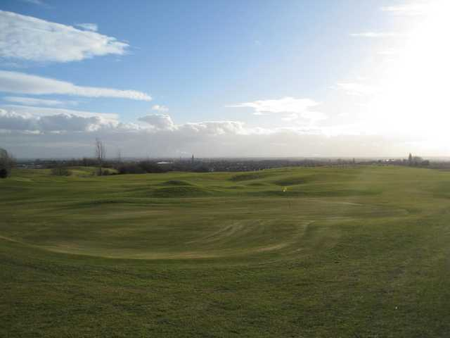 The sun shining over the 9th green at Hart Common Golf Club