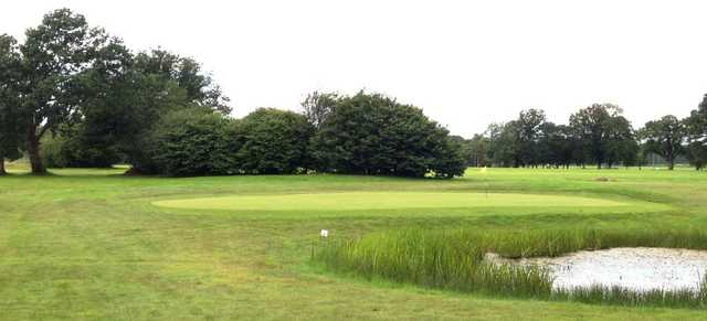 The well kept greens of Ferndown Forest Golf Club