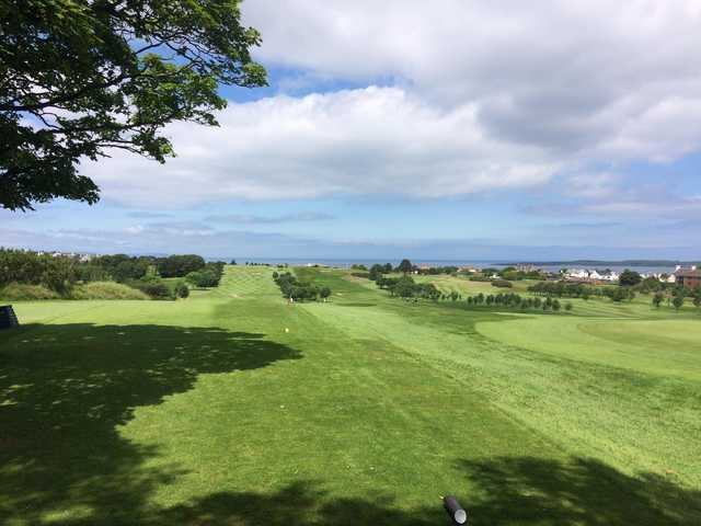The 12th green in the distance with a seaview backdrop