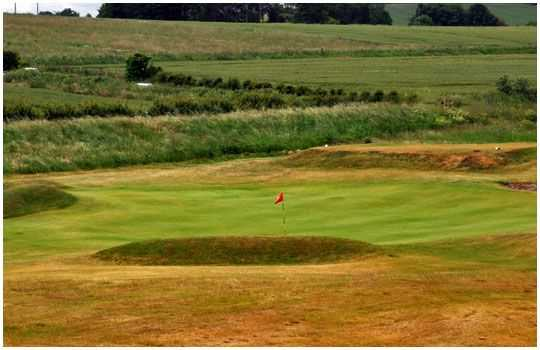 A bunker lined green at the Dunstanburgh Castle Golf Club