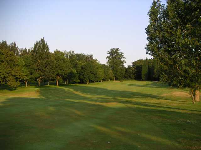 The tree lined approach to the 4th hole at Woolton Golf Club