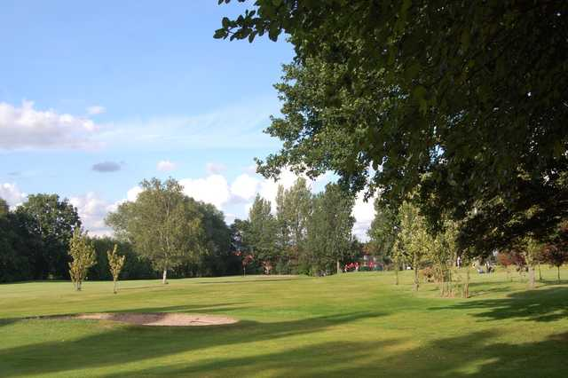 View from the trees of the 6th hole and bunker at Woolton Golf Club