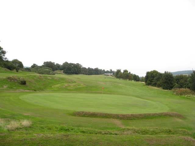 Views of the 17th green and 18th hole at St Deiniol Golf Course