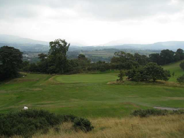 The view of the 16th green and surrounding countryside at St Deiniol Golf Course