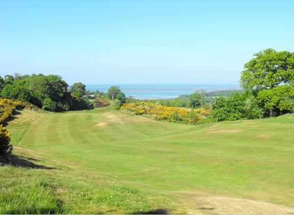 Sloping fairway on the 3rd hole from St Deiniol Golf Course