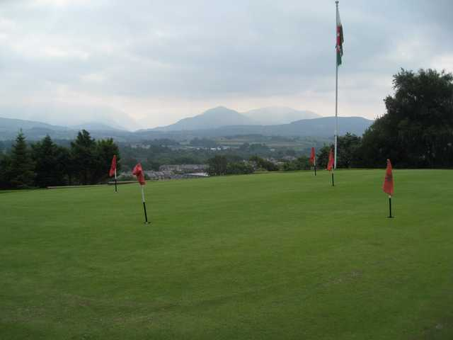 The putting green with surrounding mountains at St Deiniol Golf Course