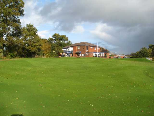 View of the 18th green and clubhouse at  Penn Golf Club