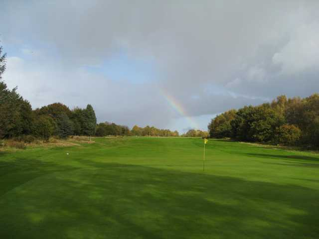The beautiful 4th hole with a rainbow in the backdrop at  Penn Golf Club