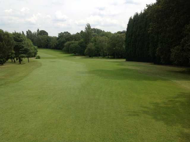 The tree lined 1st fairway at  Cocks Moors Woods Golf Club