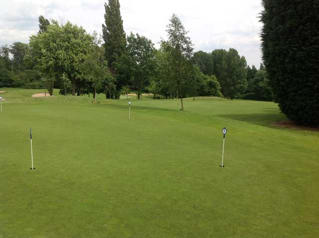 The putting green at Cocks Moors Woods Golf Club