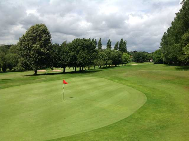 The beautiful 1st green and tree lined faiway at Harborne Church Farm Golf Club